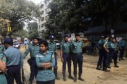 Bangladesh bans protests, locks opposition leader in office