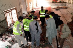 Anger, mourning in Pakistan after mosque bombing kills 59