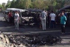 Iraqi officials say car bomb blast kills 14 people northeast of Baghdad