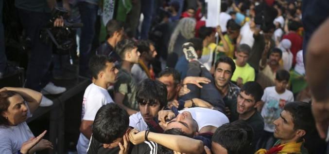 2 killed in explosions at Kurdish rally in Turkey