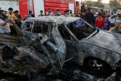 Bomb attacks kill 15 in, around Iraqi capital