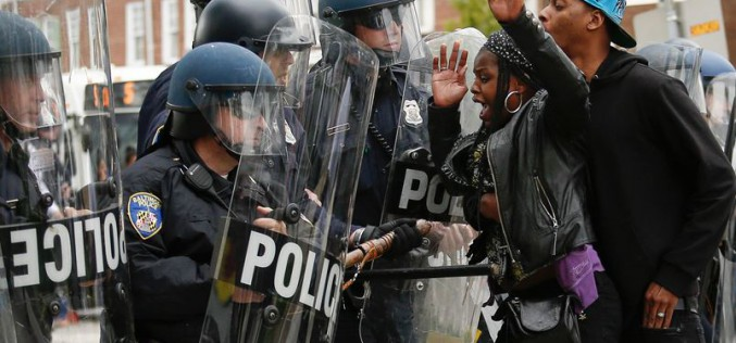 Baltimore erupts in riots after funeral of black man who died in police custody
