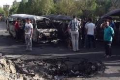 Iraqi officials say car bomb blast kills 14 people northeast of Baghdad